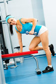 Female athlete dumbbell — Stock Photo