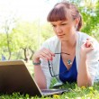 Stock Photo: Portrait of a woman witha laptop