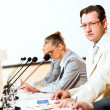 Businessmen communicate at conference — Stock Photo #18673371