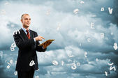 Business man is working with tablet — Stock Photo