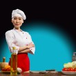 Portrait Asian woman cooks — Stock Photo #18726231