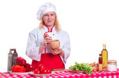 Attractive woman cooks — Stock Photo