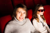Young couple in the cinema — Stock Photo
