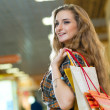 Stock Photo: Portrait of beautiful womin shopping center
