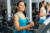 Young women running on a treadmill — Stock Photo