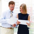 Постер, плакат: Business man and business woman in the office
