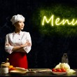 Asian female chef looking at the glowing menu — Foto de Stock