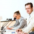 Businessmen communicate at conference — Stock Photo #19121357