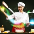 Stock Photo: Asifemale chef in kitchen conjures