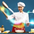 Asian female chef in the kitchen conjures — Stock Photo #19205147