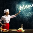 Woman cook touch glowing word menu — Stock Photo