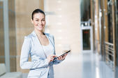 Business woman with tablet pc — Stockfoto