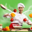 Asian female chef in the kitchen conjures - Stock Photo