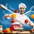 Asian female chef in the kitchen conjures — Stock Photo #19407815
