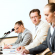 Businessmen communicate at conference — Stock Photo #19408027
