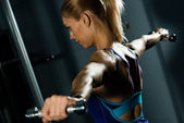 Female athlete dumbbell — Stock Photo