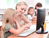 Teacher explains the task schoolgirl — Stock Photo
