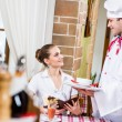 Chef brings a dish pretty woman in a restaurant — Stock Photo #20254917