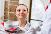 Waiter brings a dish for a nice woman — Stock Photo