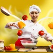 Asian female chef in the kitchen conjures — Stock Photo