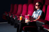Woman sitting in a cinema — Foto de Stock