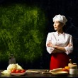Asifemale chef looking at empty space — Stock Photo #21818435