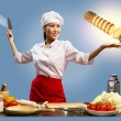 Asian female chef cuts pineapple — Stock Photo