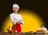 Portrait Asian woman cooks — Stock Photo