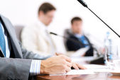 Businessman writing on paper notes — Stock Photo