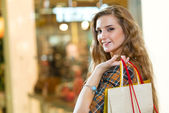 Portrait of a beautiful woman in a shopping center — Stock Photo