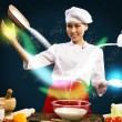 Asian female chef in the kitchen conjures — Stok fotoğraf