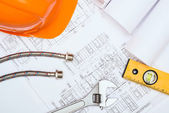 Plumbing and drawings, construction still life — Stock Photo