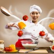 Asian female chef in the kitchen conjures — Stock Photo #22695617