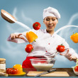 Asian female chef in the kitchen conjures — Stock Photo #22695789