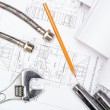 Plumbing and drawings, construction still life - Stock Photo