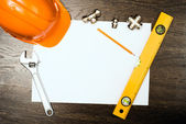 Plumbing tools on a white sheet of paper — Stock Photo