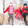 Photo: Boy and girls playing with snow in winter park