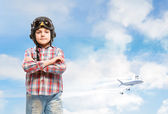 Boy in helmet pilot dreaming of becoming a pilot — Stock Photo
