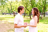 Couple holding hands in the park — Stock Photo