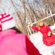 Children in Winter Park playing snowballs — Stock Photo #23310158