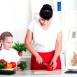 Stock Photo: Mom and daughter cooking together