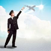 Pilota sotto forma di tendere una mano all'aeroplano — Foto Stock