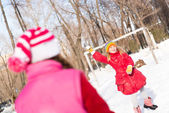 Children in Winter Park playing snowballs — Stock Photo
