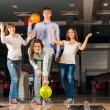Group of young friends playing bowling — Стоковая фотография