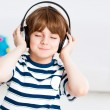 Boy listening to music - Stock Photo