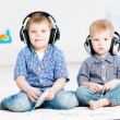 Two brothers playing on a games console — Stock Photo #23980487