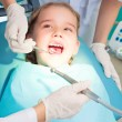 Girl visiting dentists, visit the dentist — Stock Photo #23980671