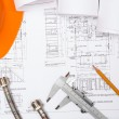 Plumbing and drawings, construction still life — Stock Photo #23980679