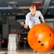 Stock Photo: Young mplaying bowling