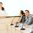 Businessmen communicate at conference — Stock Photo #23980745